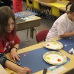 Simone begins painting.